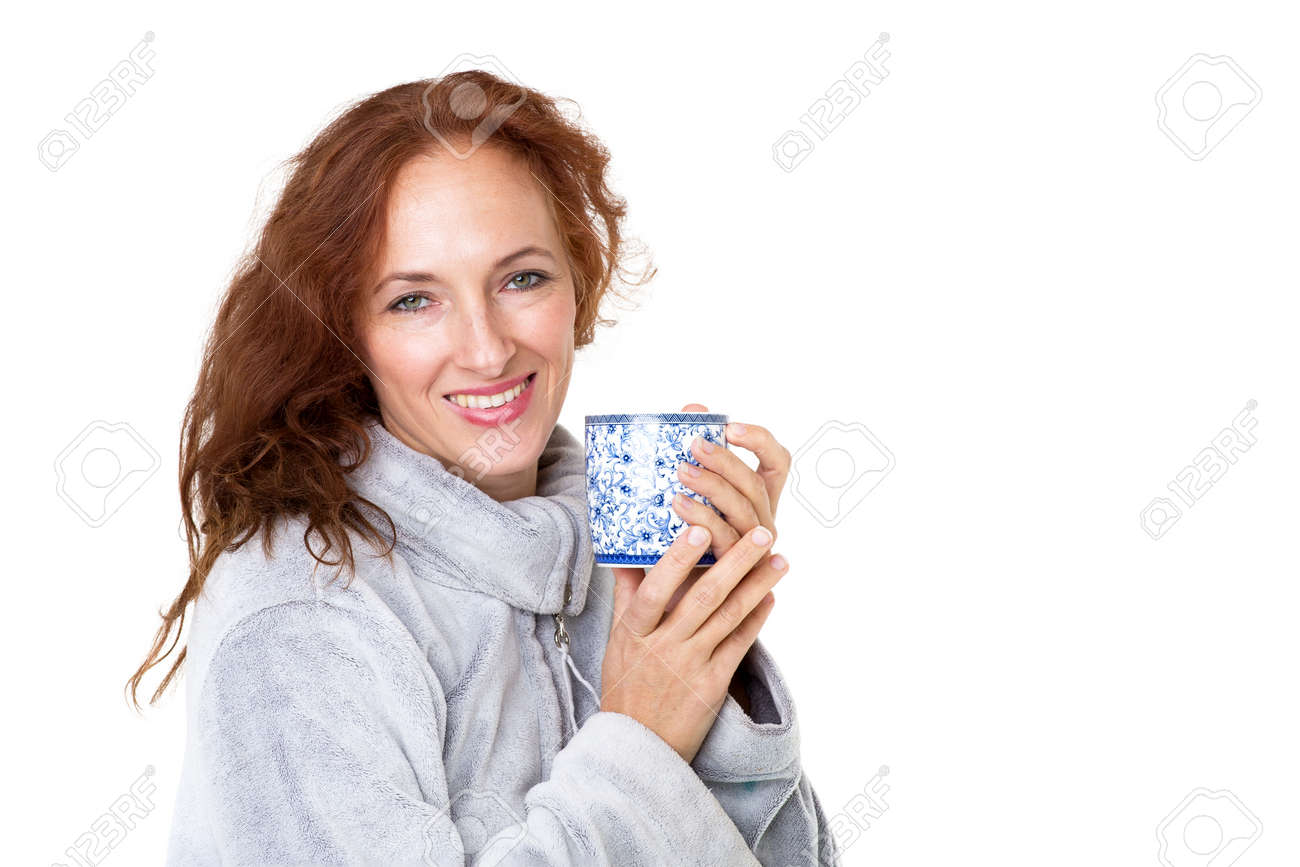 Smiling woman holding porcelain mug - 173271244