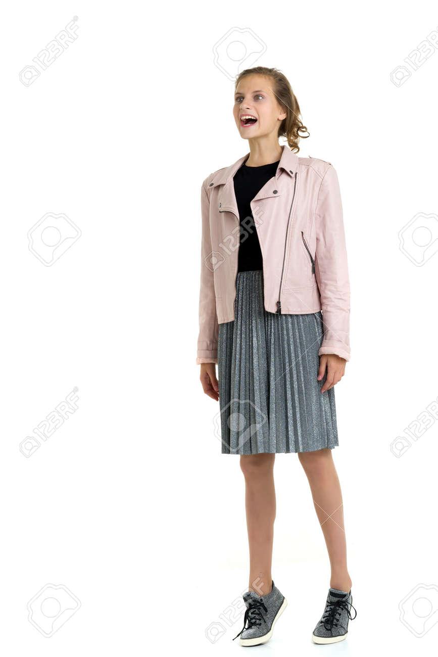 Pretty fashionable stylish teenage girl. Isolated over white background. - 173275260
