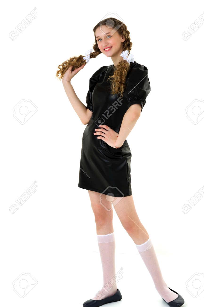 Happy girl in black dress and knee socks - 173275283