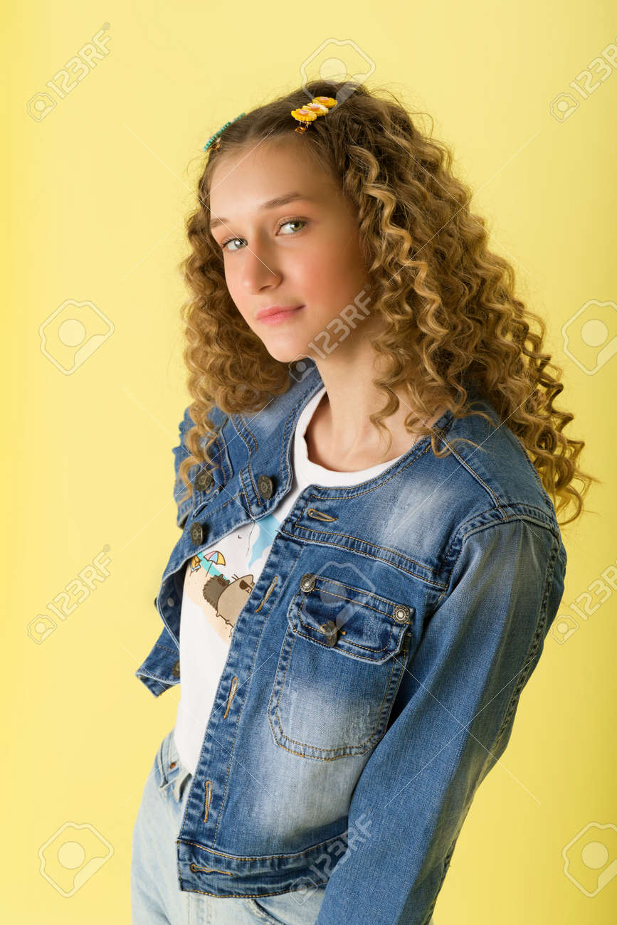 Close up portrait of teen girl with curly hair - 173281255