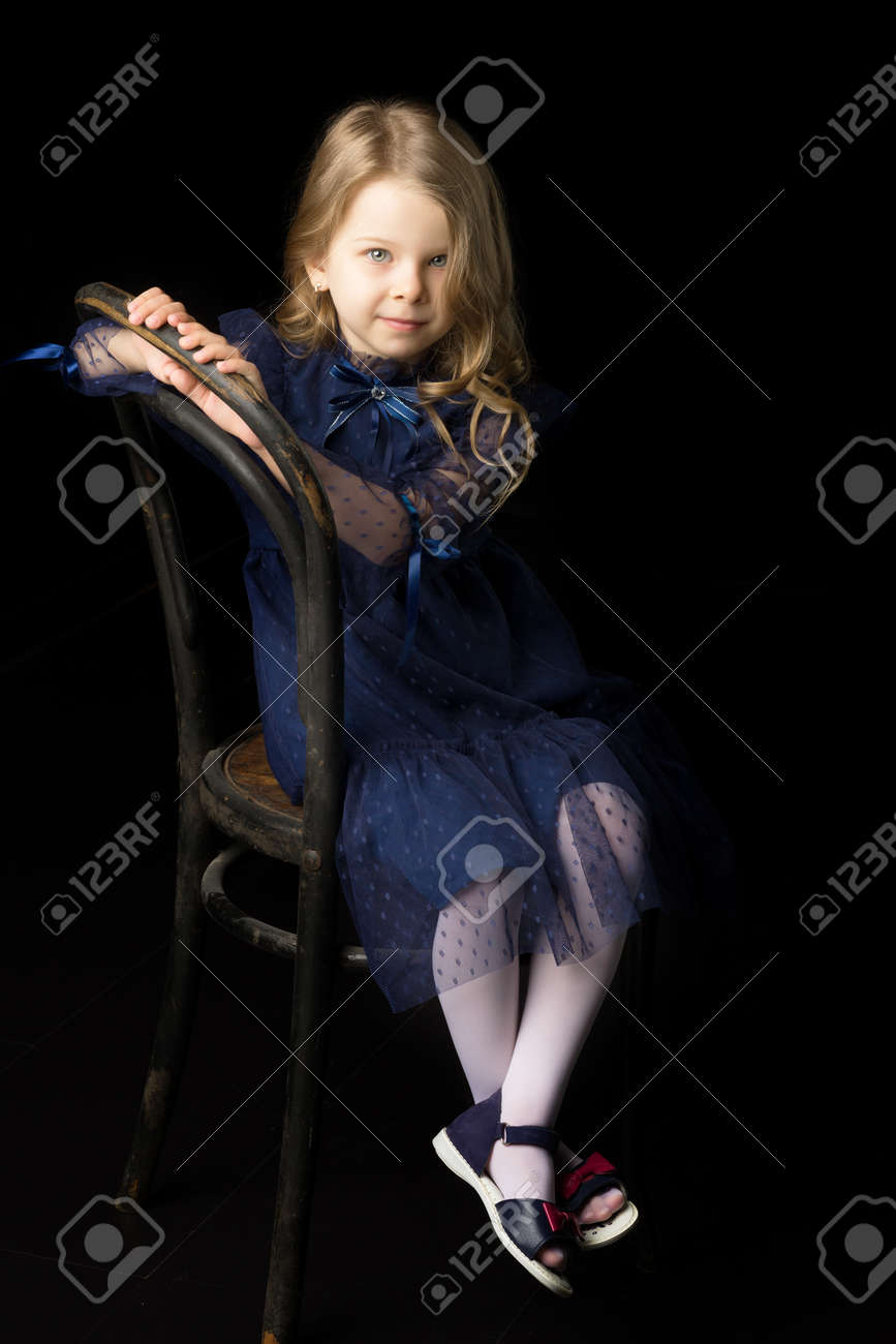 Close up portrait of happy sitting little girl - 173365944