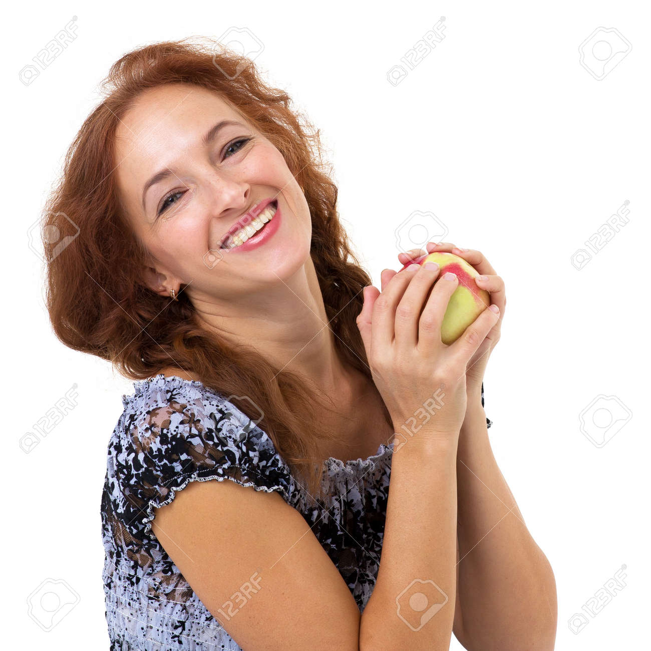 Happy woman holding fresh red apple. - 173426137