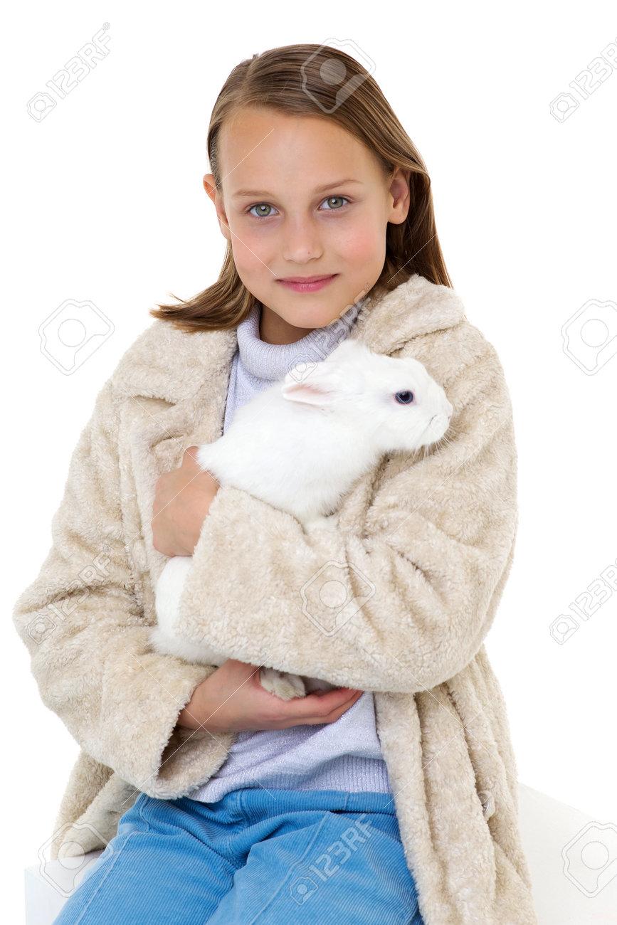 Stylish girl holding white rabbit - 173438627