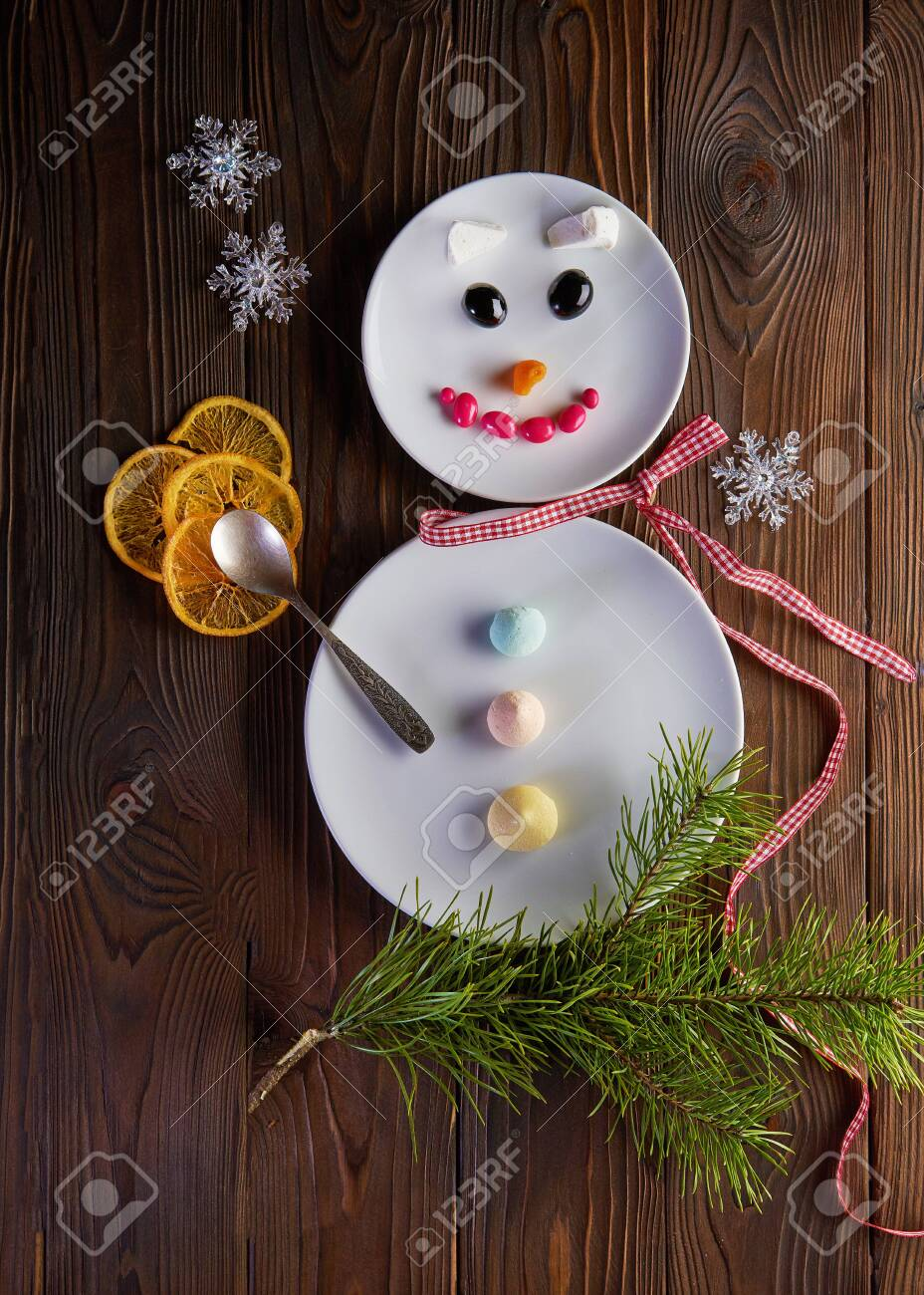 Funny snowman - Christmas and New Year fun food art. Top view - 131905226