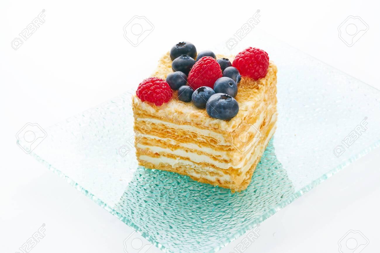 Tasty fruit cake on white background - 131905315