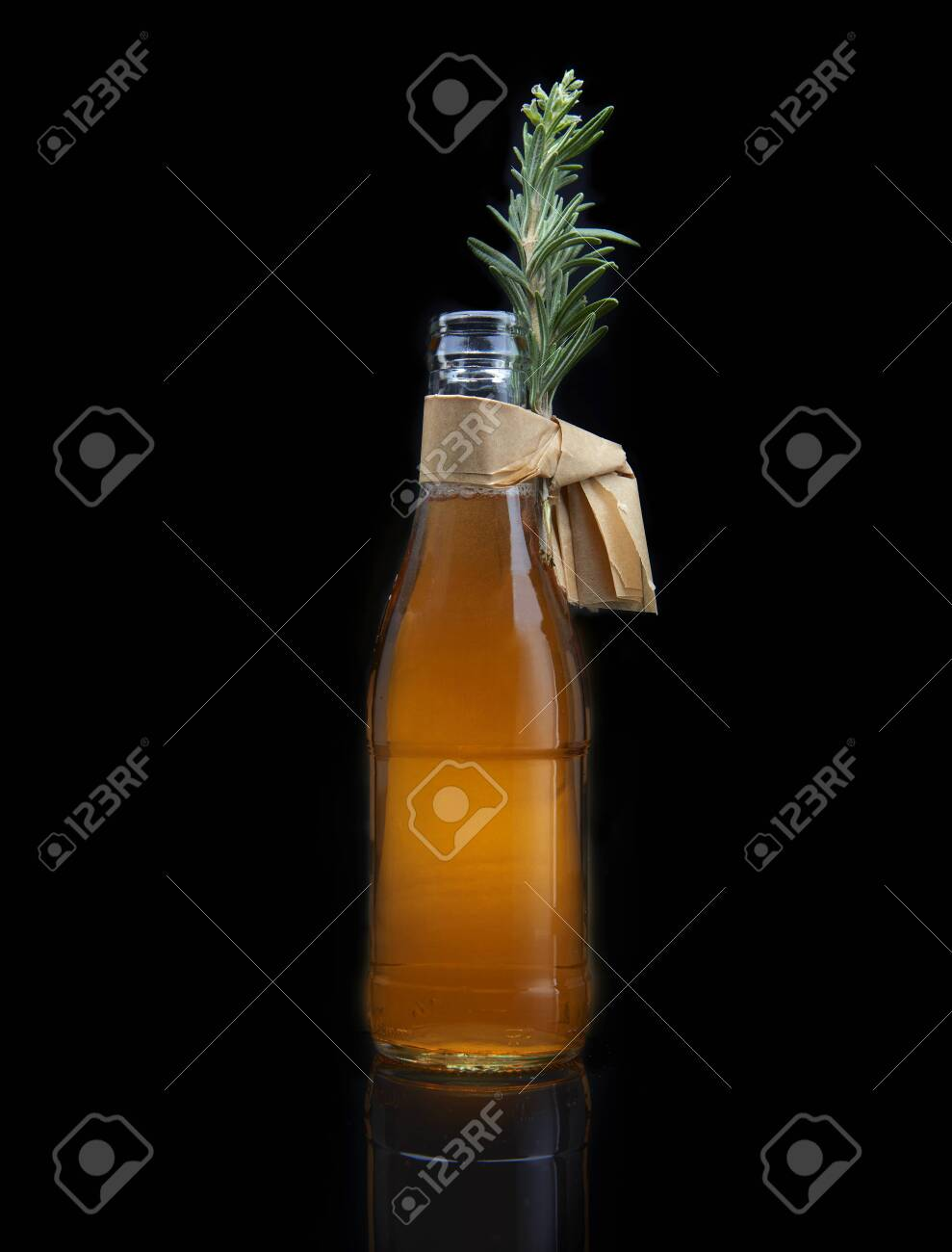 refreshing cocktail in bottle with rosemary, on black background - 131905283