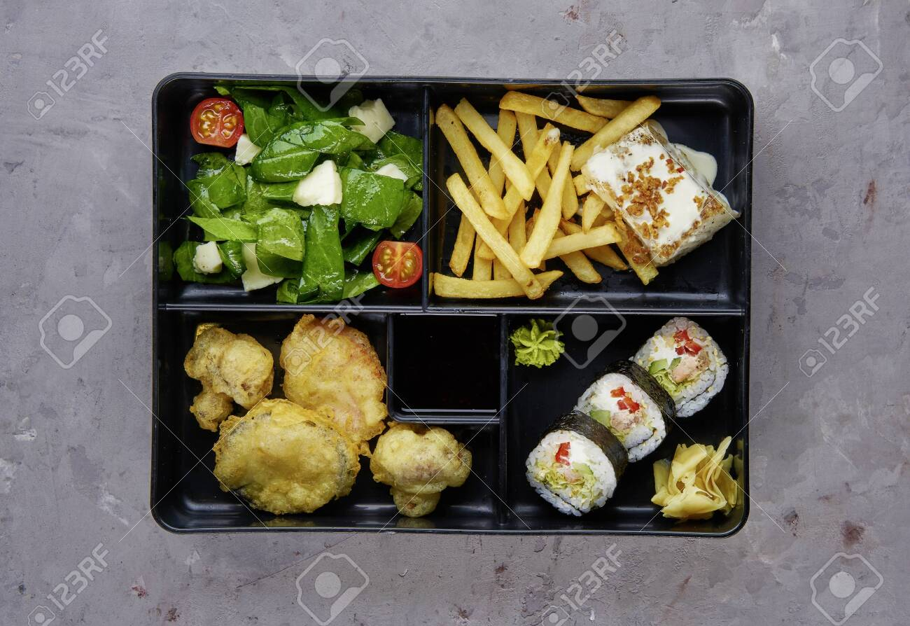 Fresh Food Portion in Japanese Bento Box with Sushi Rolls, - 133057627