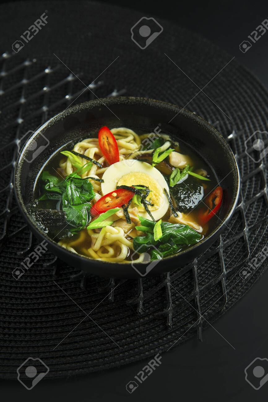 Traditional asian soup in bowl on black background - 133112034