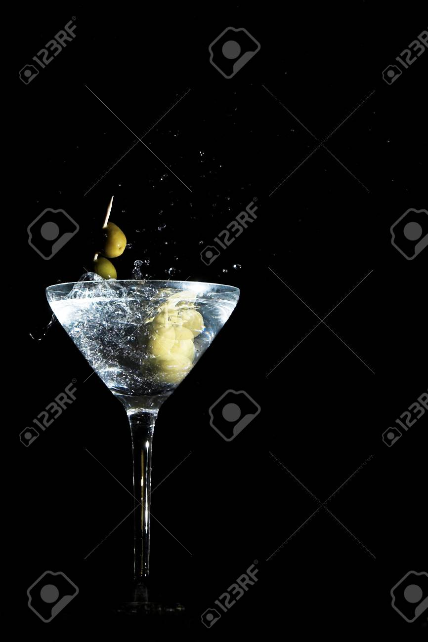 Two calamata olives on a toothpick dropped into a martini glass Stock Photo - 10191343