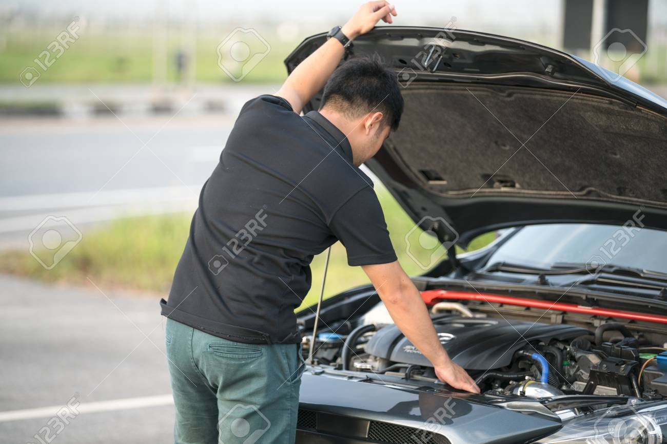 Stressed Young People Have A Problem With A Car With An Engine ...