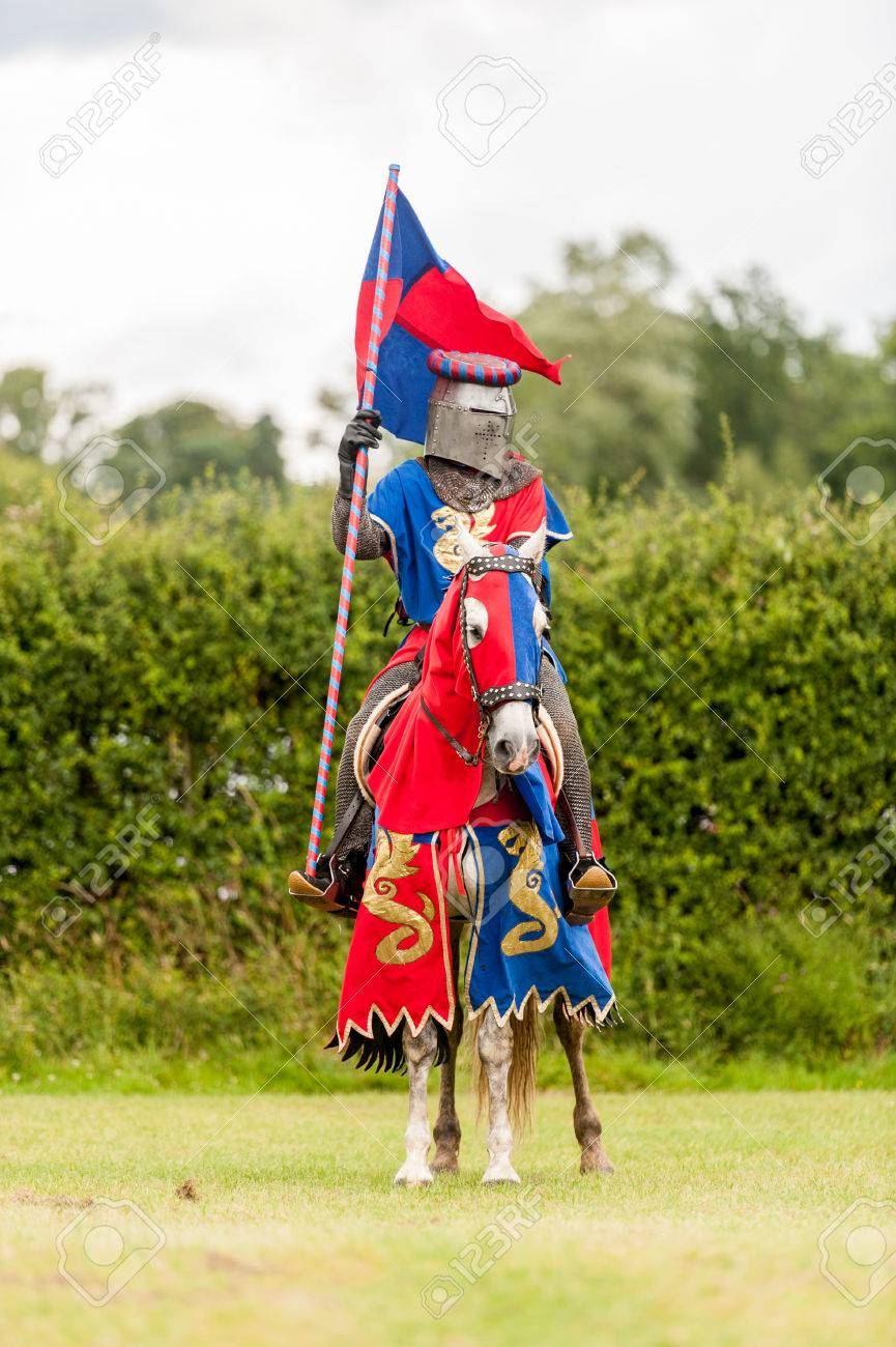 Medieval knight costume on a horse and man with flag Stock Photo - 50604384 & Medieval Knight Costume On A Horse And Man With Flag Stock Photo ...