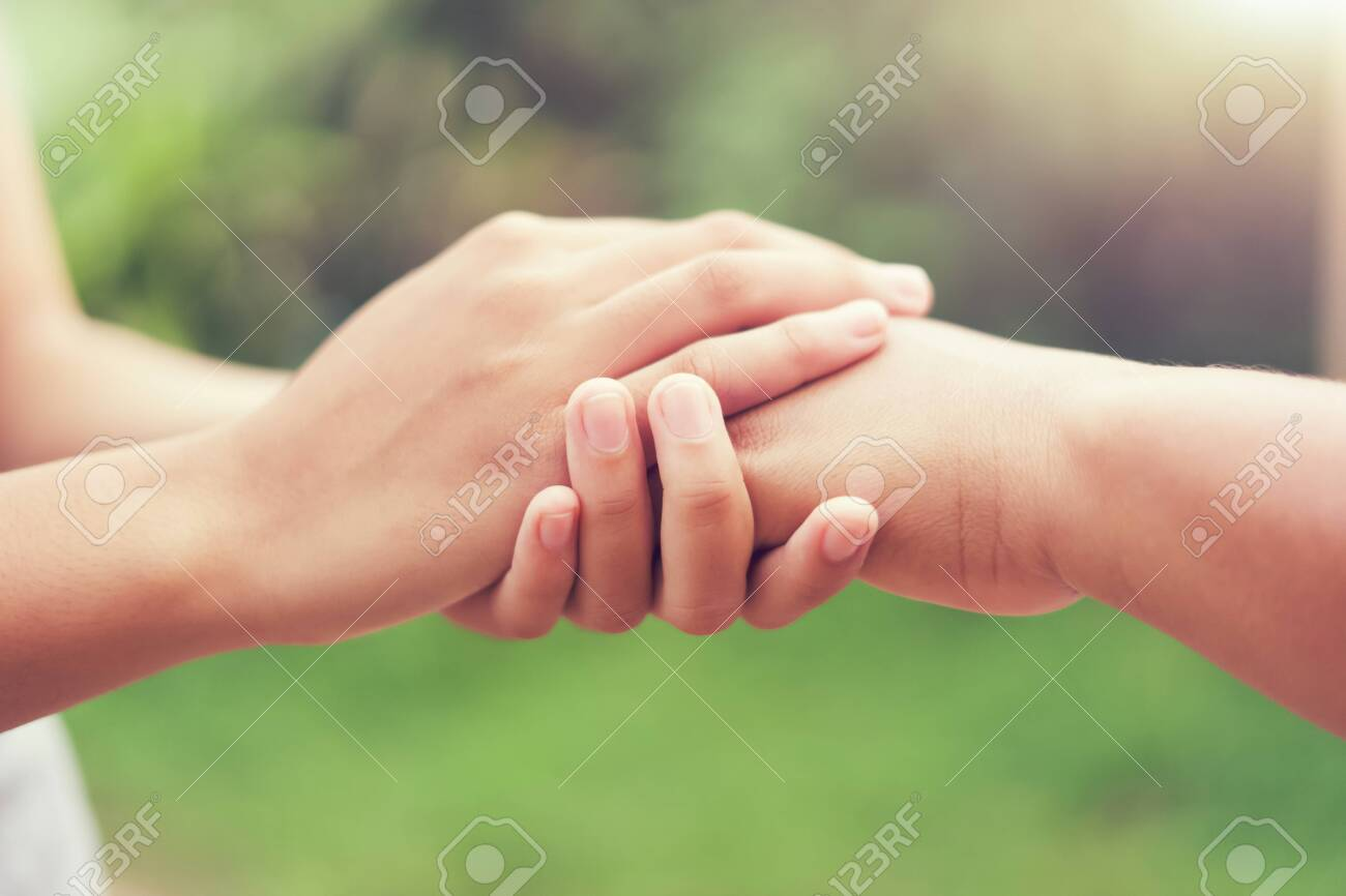people old and young hand holding with sunlight. concept power of hope - 130721188