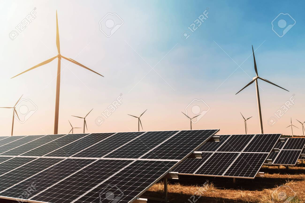 clean energy concept. solar panel with wind turbine and blue sky - 130720598