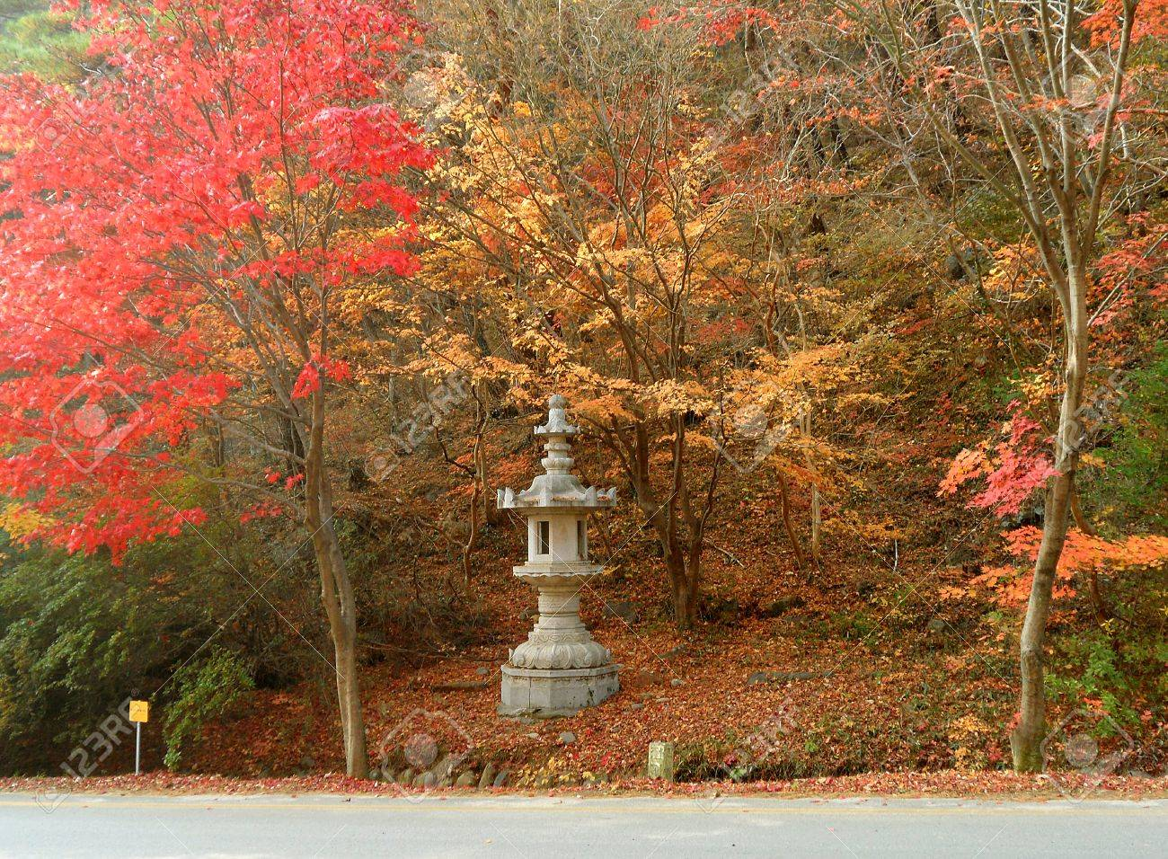 e1aa818f071f5 Ancient Korean Style Stone Lantern Amongst beautiful Fall Colors on the  Mountain Road of South Korea