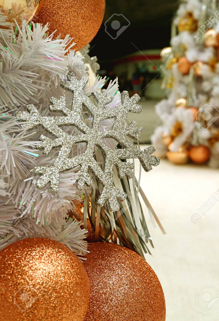 Closed Up Silver Glitter Snowflake And Pink Gold Ball Shaped Christmas Ornaments With Blurred