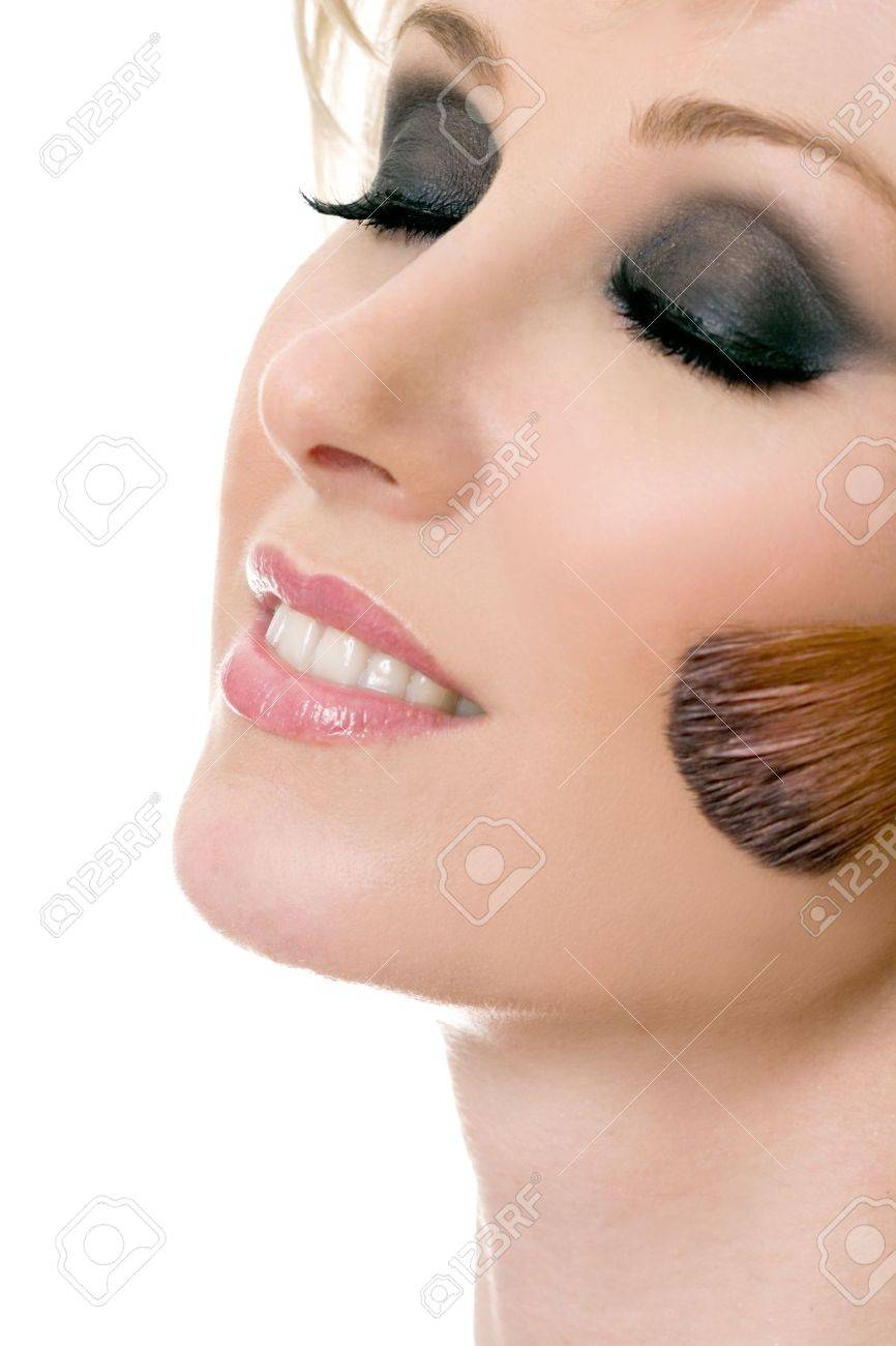 Female face and brush applying powder rouge to cheeks. Stock Photo - 524436