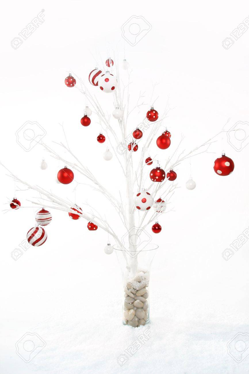 White christmas tree with red decorations - Stock Photo White Modern Christmas Tree Decorated With Red And White Christmas Baubles Theme