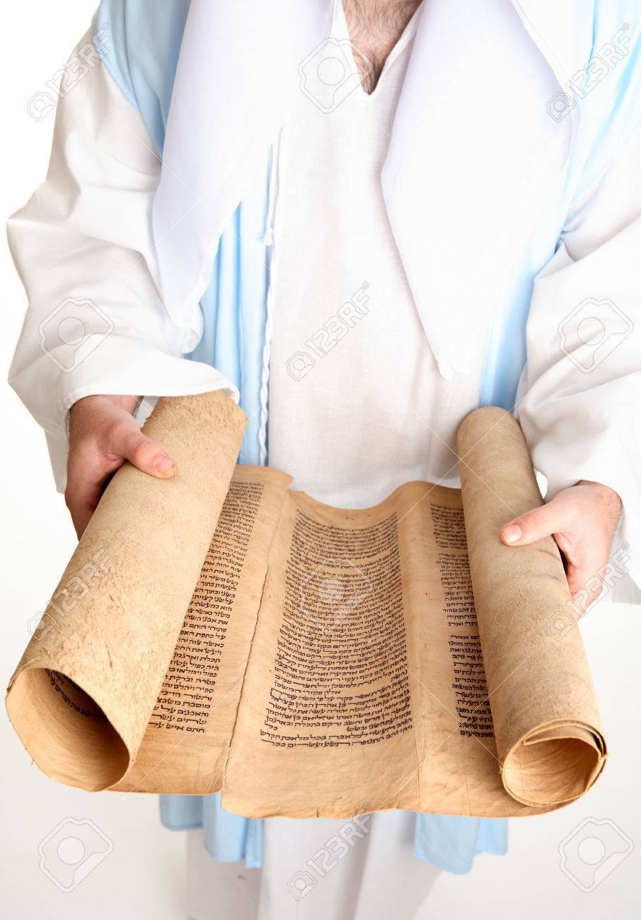 Focus to scroll.The Torah for reading in public must be written on the skin (parchment) of a clean animal, beast or fowl (comp. Lev. xi. 2 et seq.). The parchment must be prepared specially for use as a scroll, with gallnut and lime and other chemicals th Stock Photo - 1511049