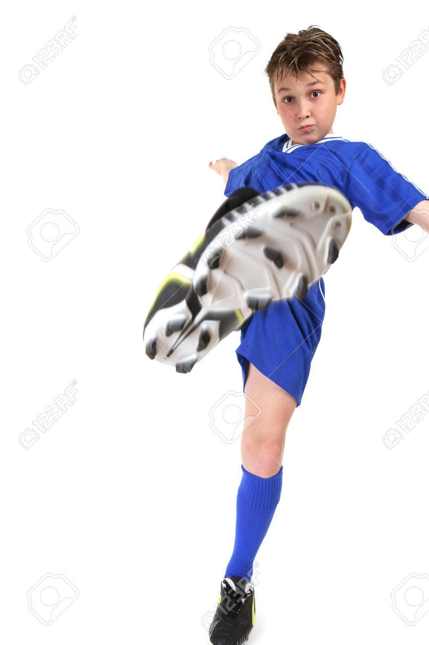 a boy kicks high kicking leg in motion stock photo picture and