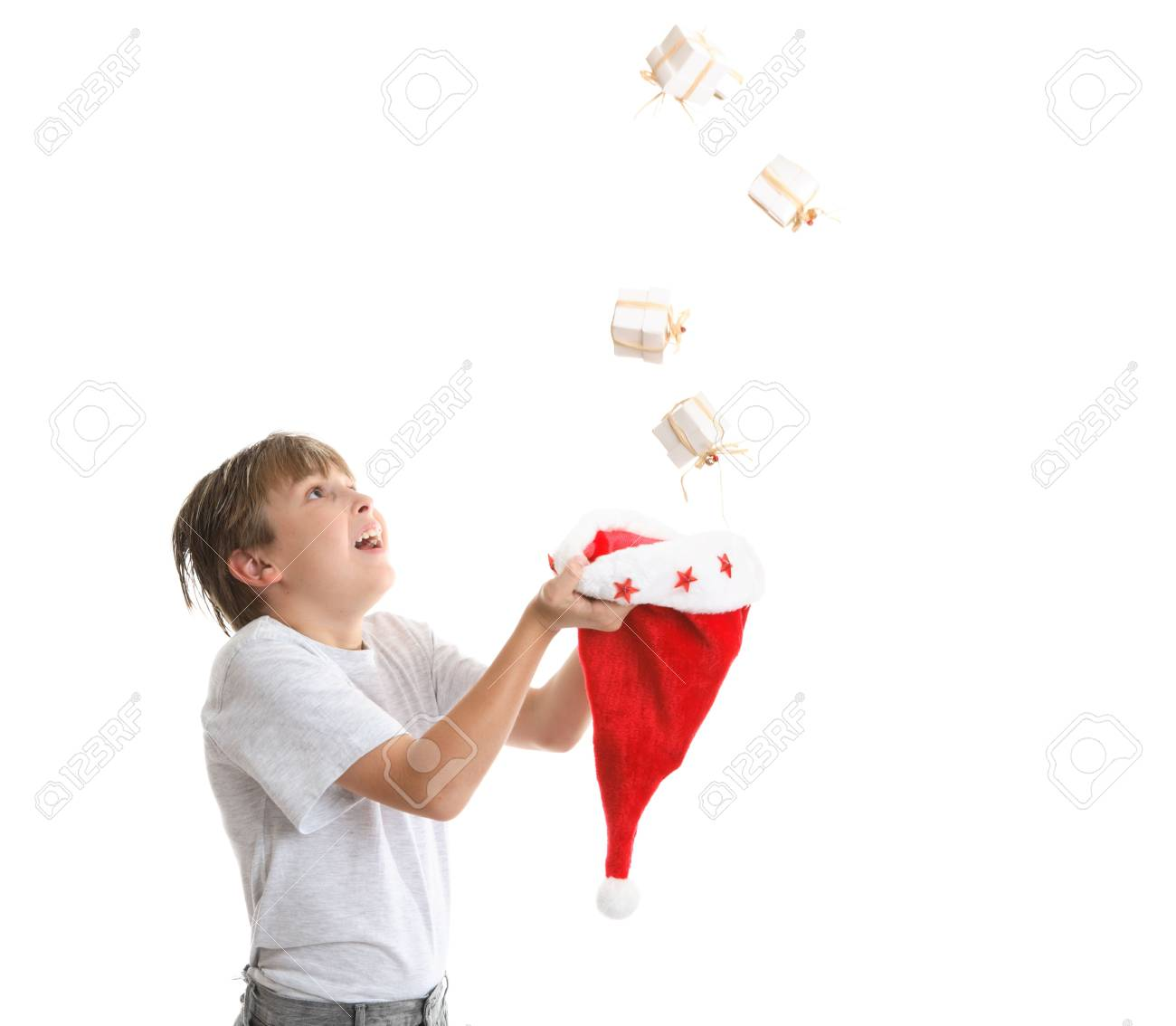 Boy looking up is catching falling Christmas presents Stock Photo - 2084904