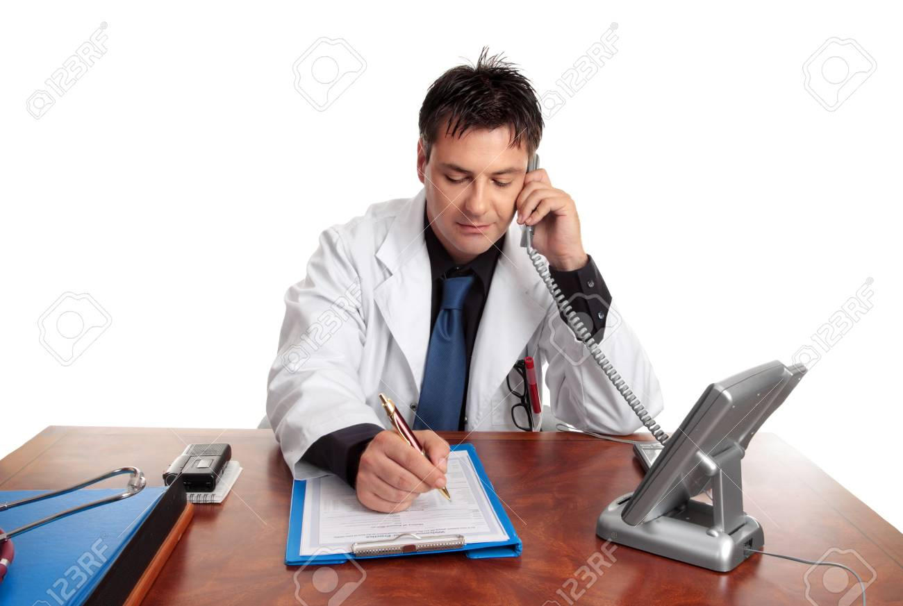 Doctor on the phone fills out patient information sheet. Stock Photo - 2602459
