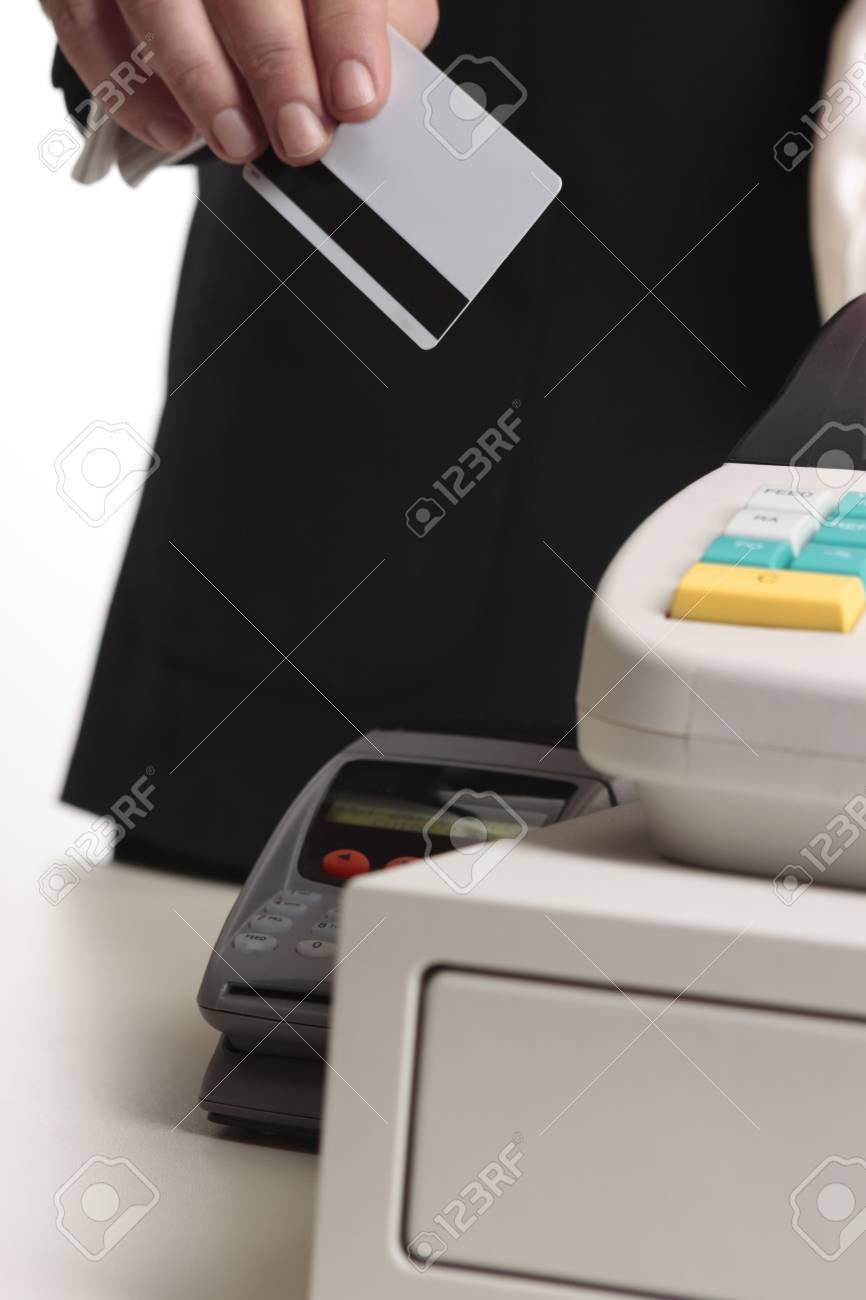 A man hands his credit or debit card at checkout for payment.   Focus to card, shallow dof Stock Photo - 3763048