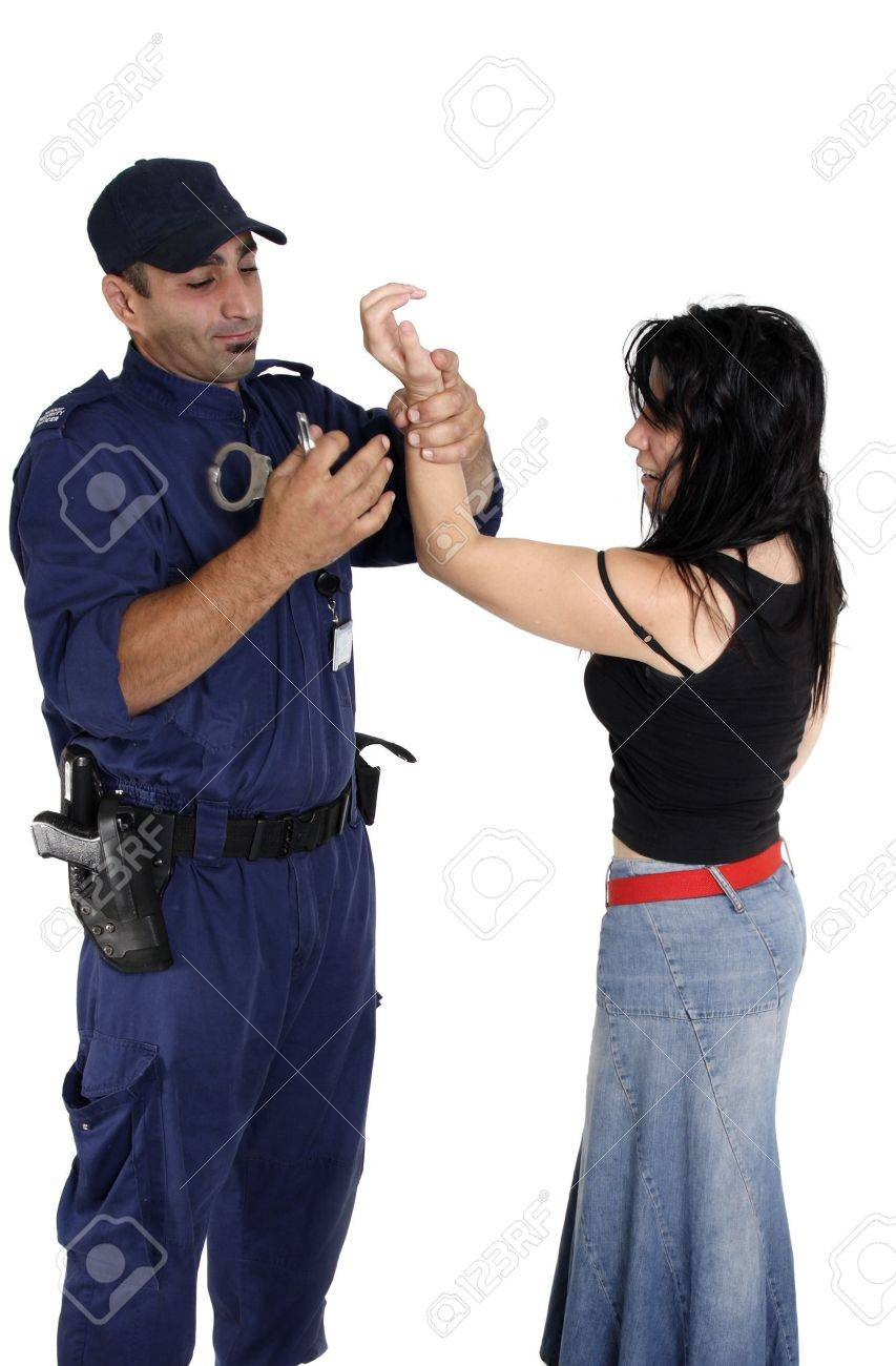 A male security officer handcuffs a female.  Cuffs show motion. Stock Photo - 3914094
