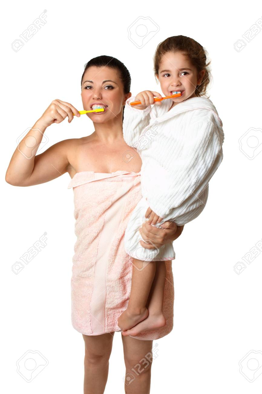 A mother and  her young daughter brushing their teeth . Stock Photo - 5278987