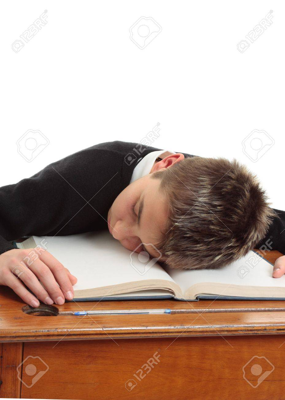 Tired, bored, weary, stressed school student at desk. Stock Photo - 7277685