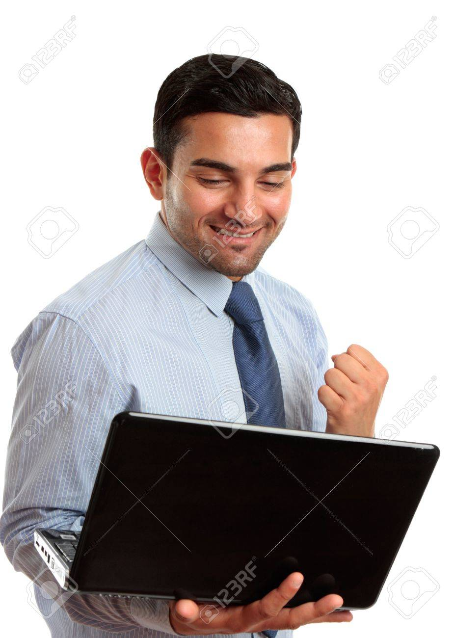 A happy excited business man with holding a laptop and showing a fist of success, or victory.  White background. Stock Photo - 7362148