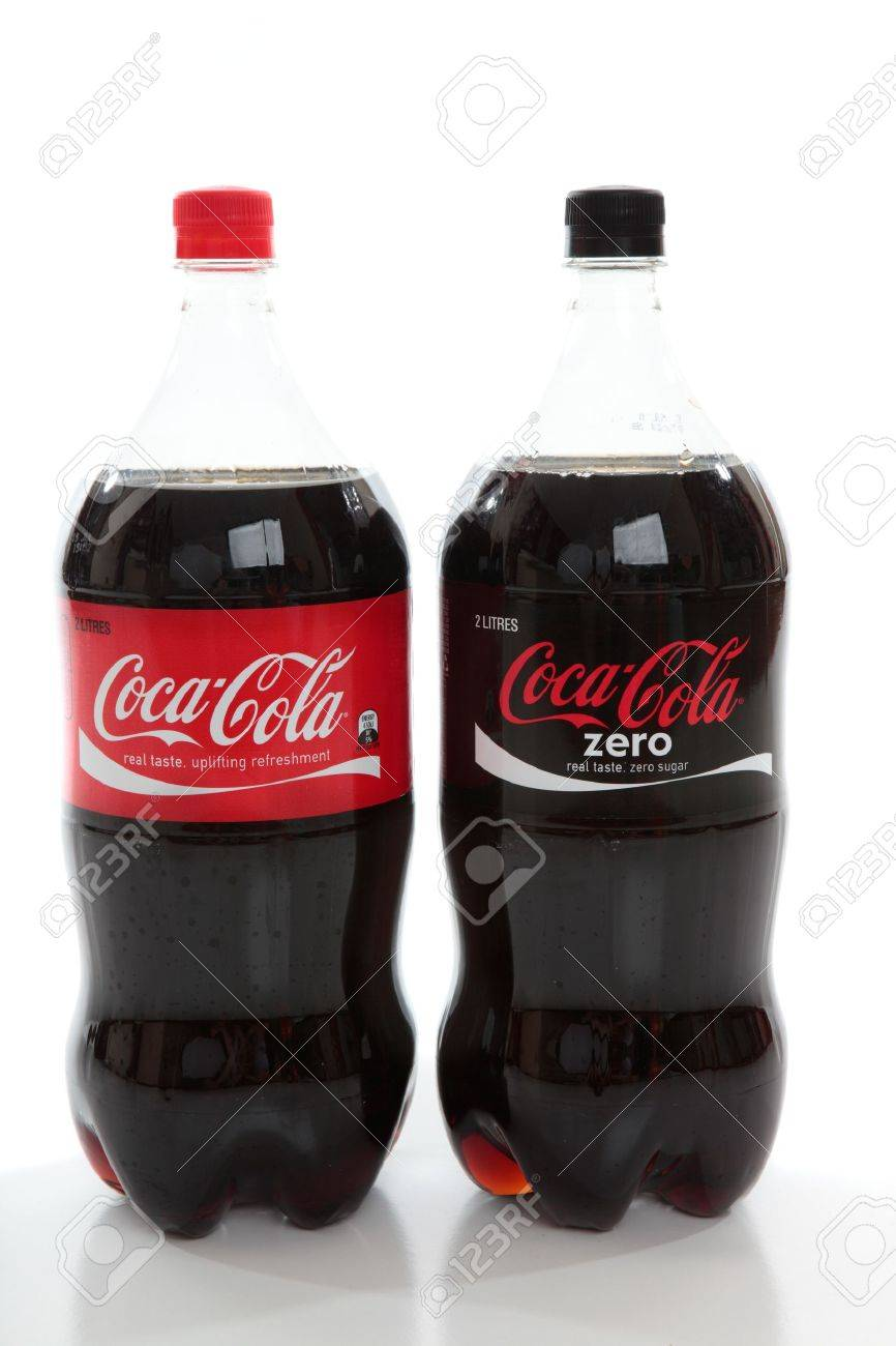 Bottles of Coca-Cola and Coke Zero, diet cola, caffeine flavoured carbonated drinks,soda drinks on a white background. Stock Photo - 8728258