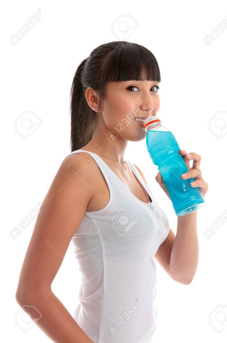 Attractive mixed race girl drinking a sports drink after exercise workout. Stock Photo - 9158373