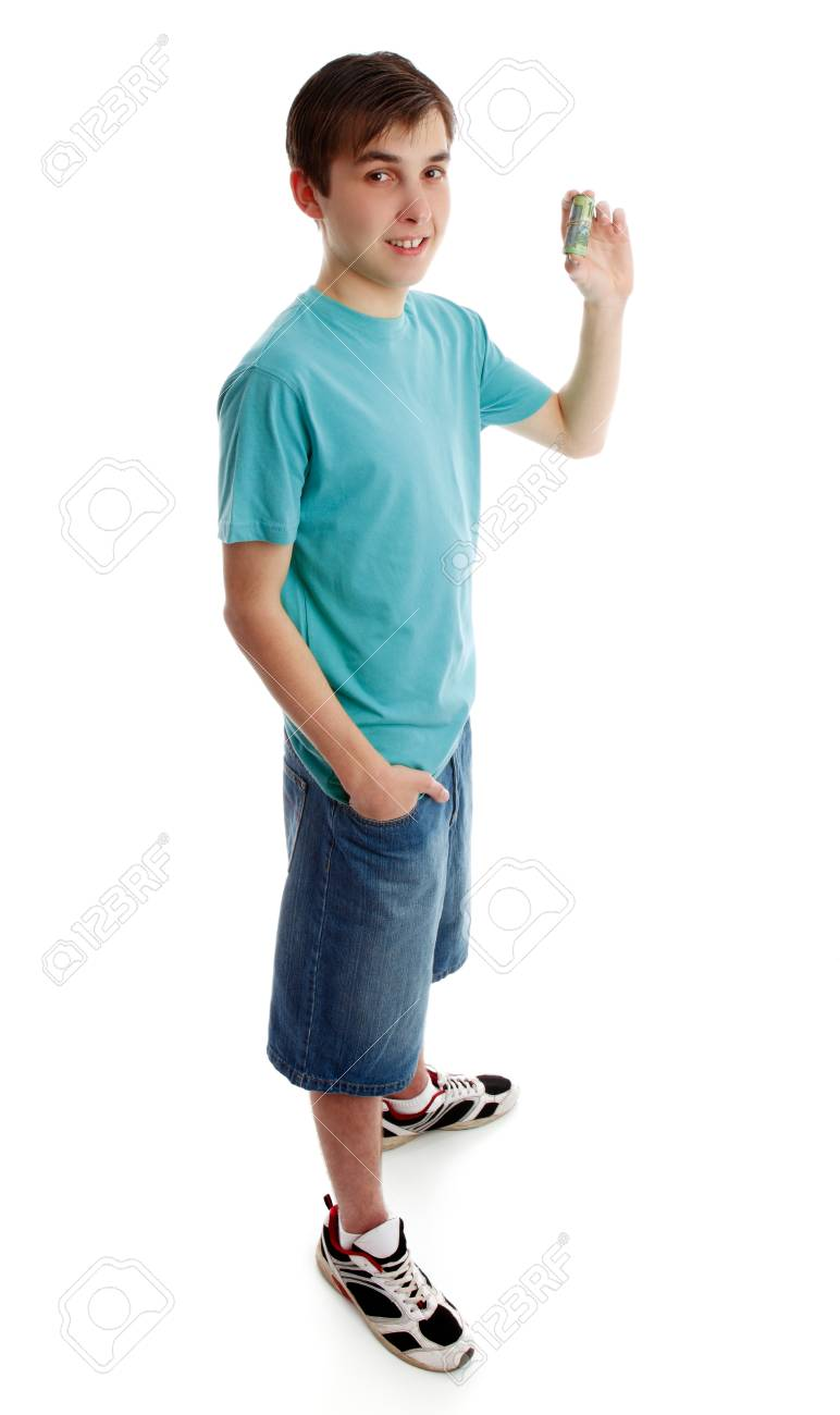 A boy showing, holding some rolled up money banknotes.  white background. Stock Photo - 10114744