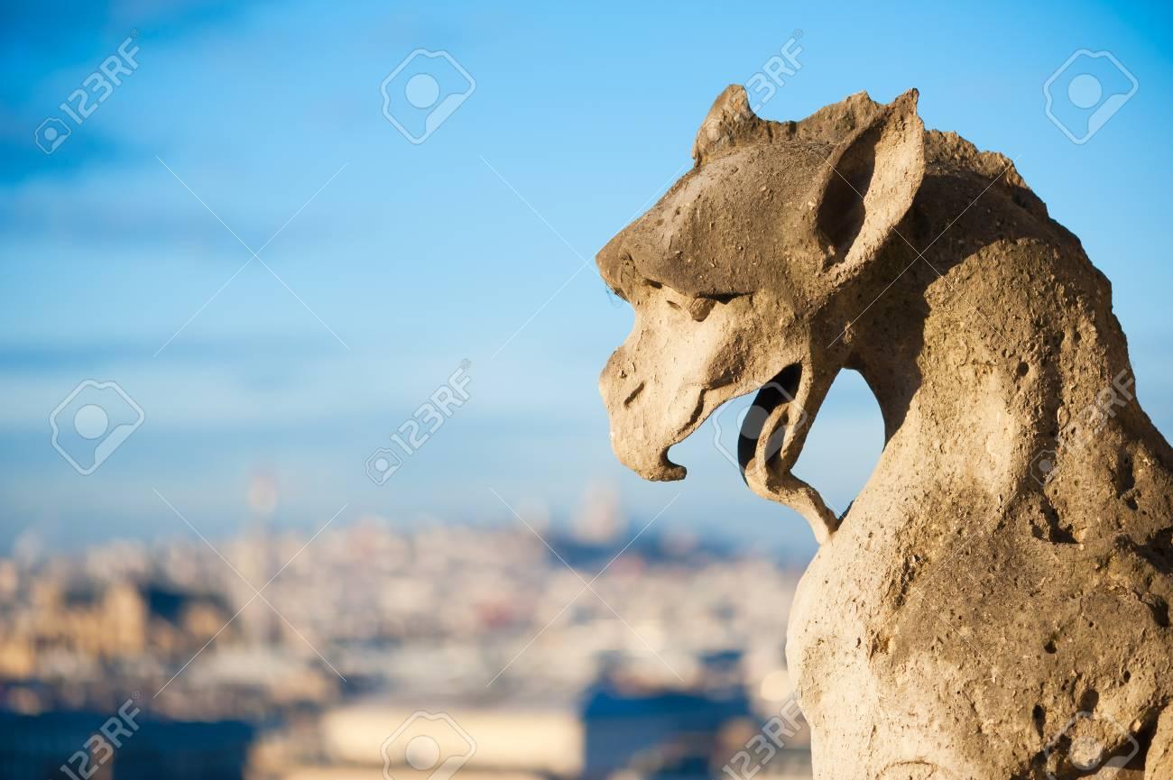 Gargoyle against blue sky and blurry city - Paris - 83862759