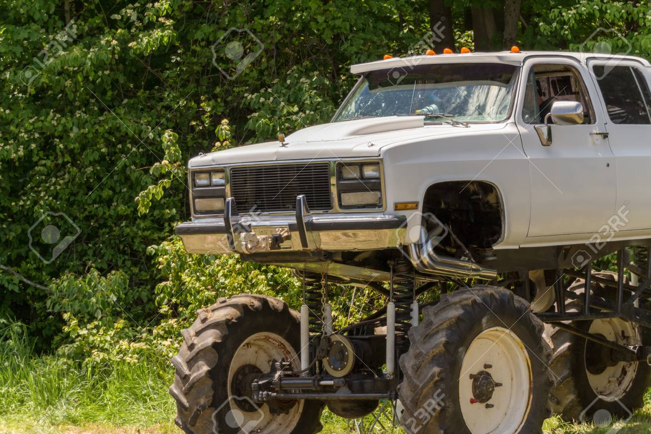 A White Pickup Truck Modified As A Monster Truck Stock Photo Picture And Royalty Free Image Image 57083240