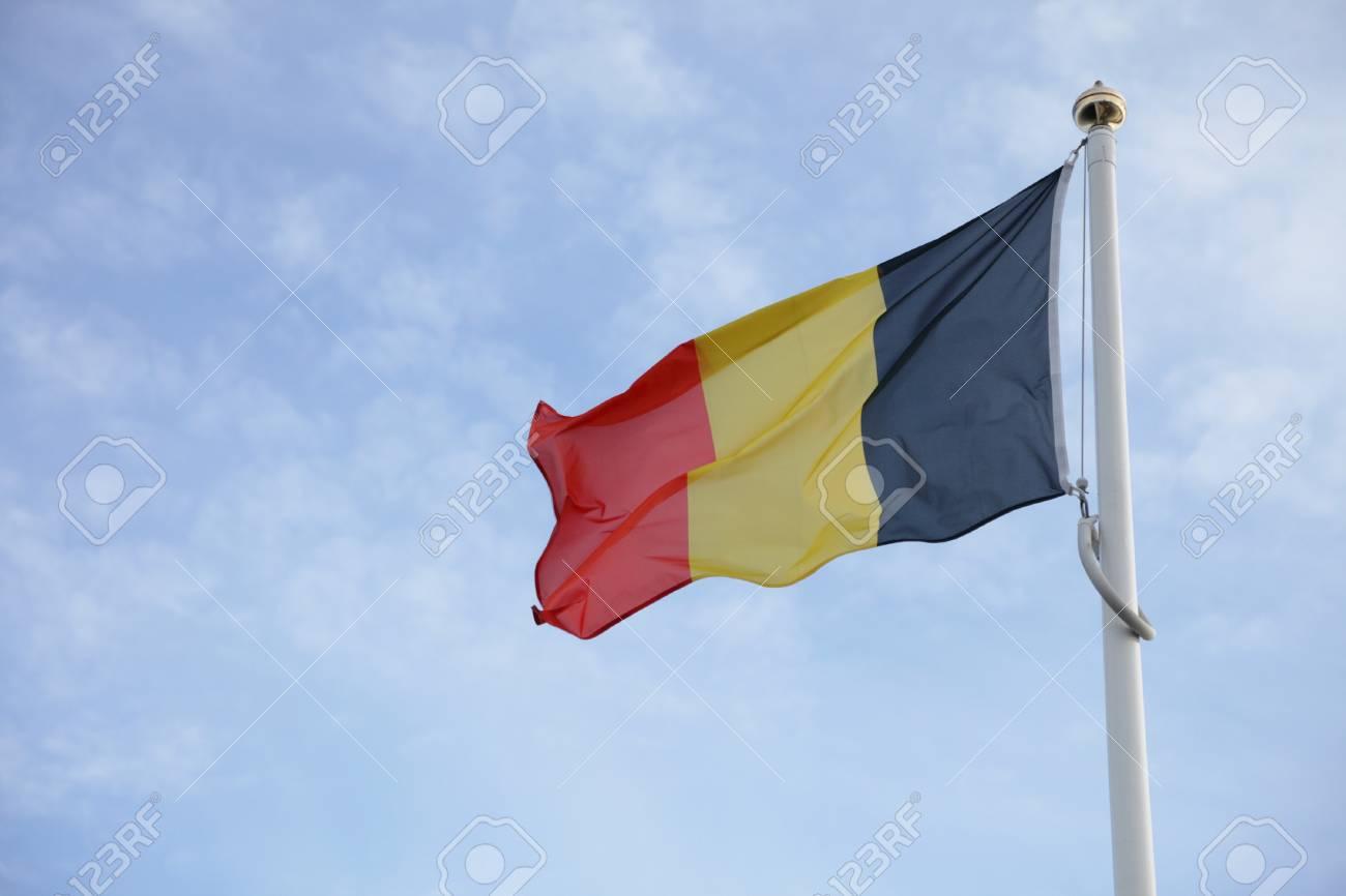 Belgium flag of on blue sky background Stock Photo - 8356371