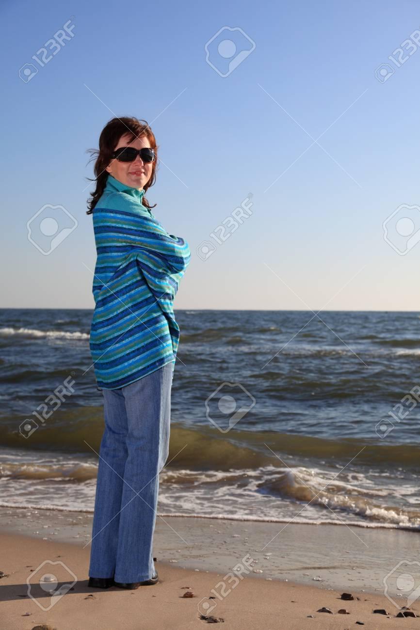 blue woman and shawl at sea shore Stock Photo - 8475955