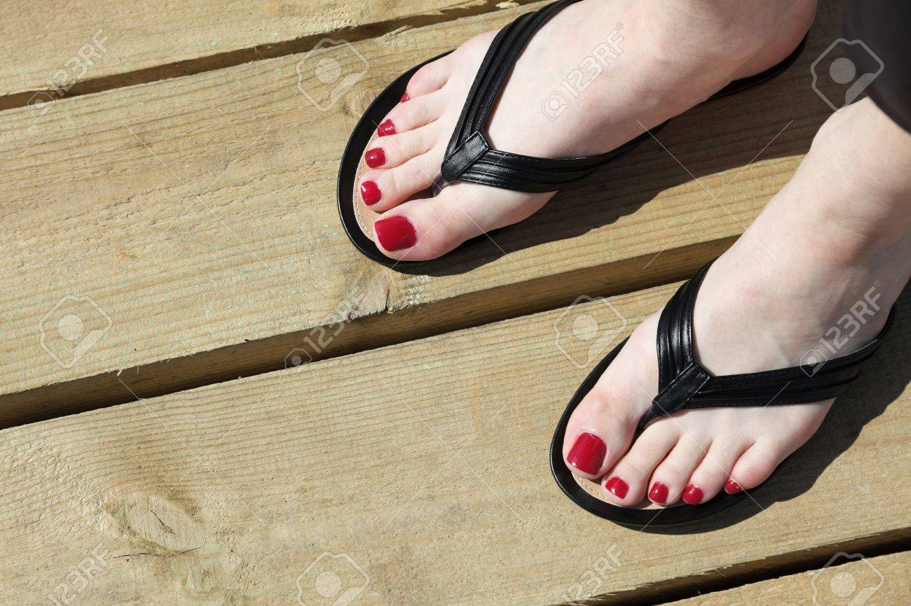 Female feet with flip-flops outdoor red nail Stock Photo - 14688445