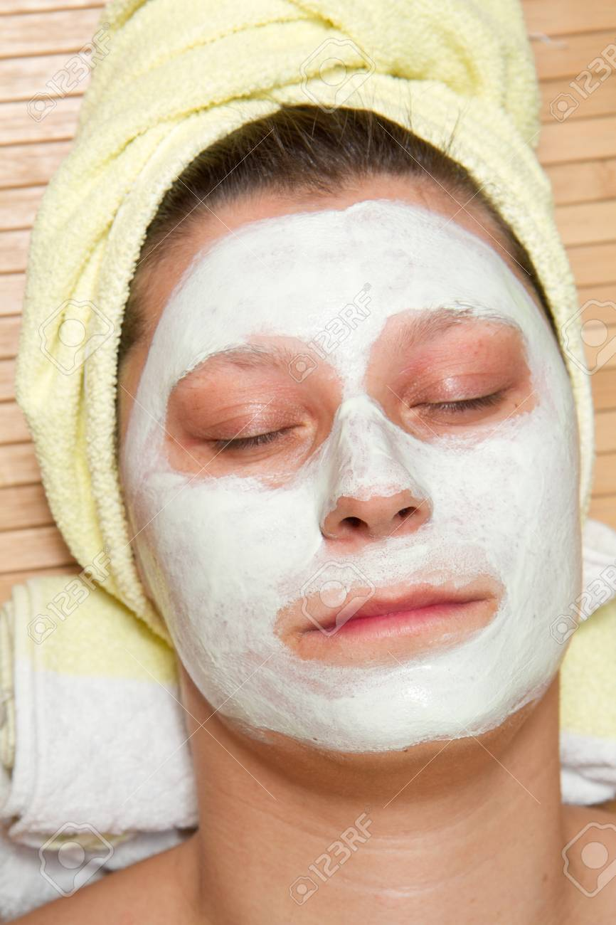 Portrait of a beautiful young girl wearing facial mud mask Stock Photo - 8859475
