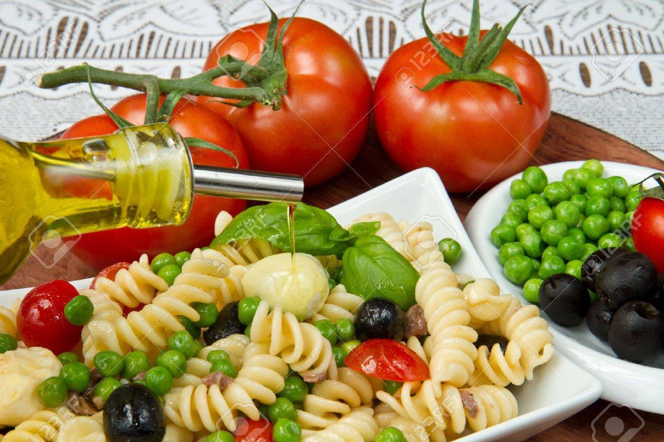 Pasta salad with mozzarella and basil Stock Photo - 9656551