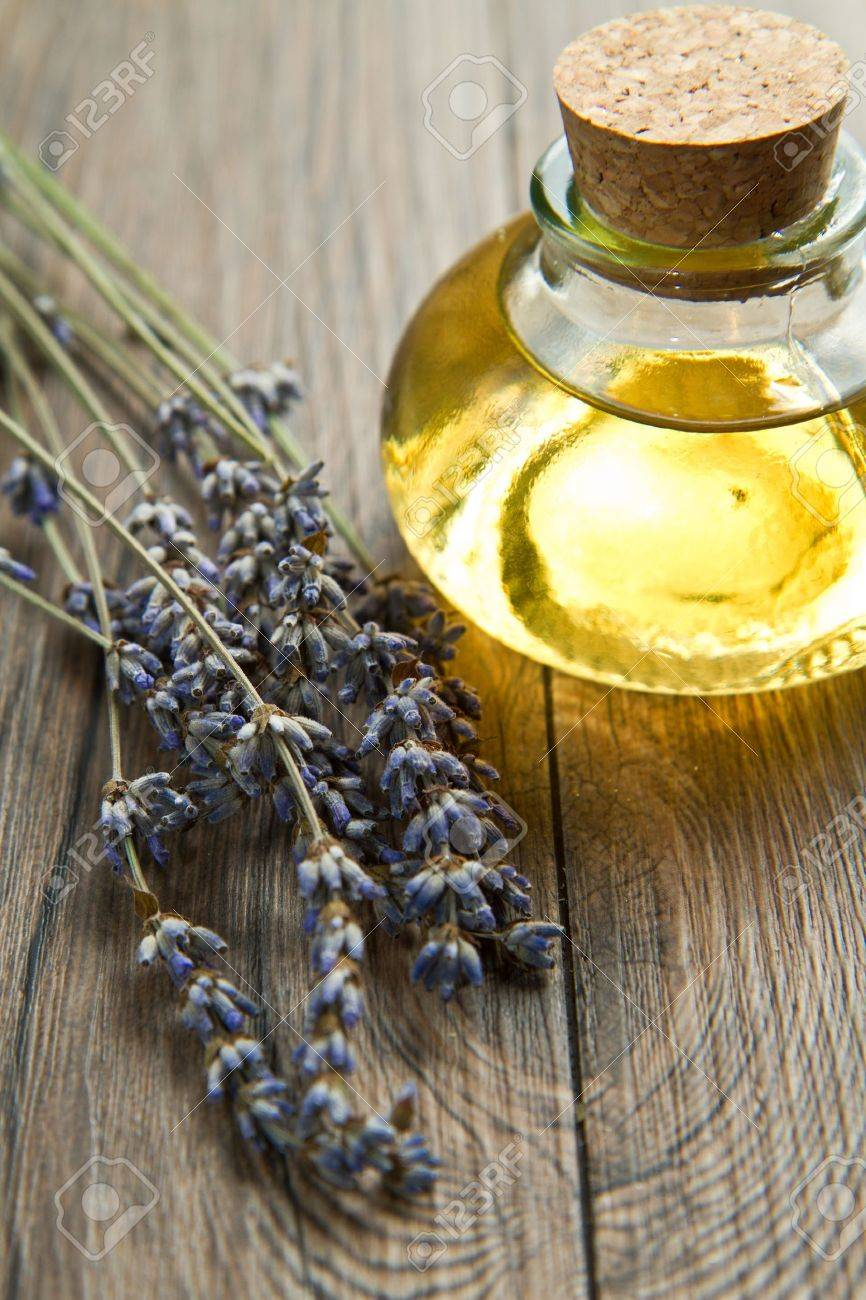 lavander oil with flowers on wooden table Stock Photo - 9776864