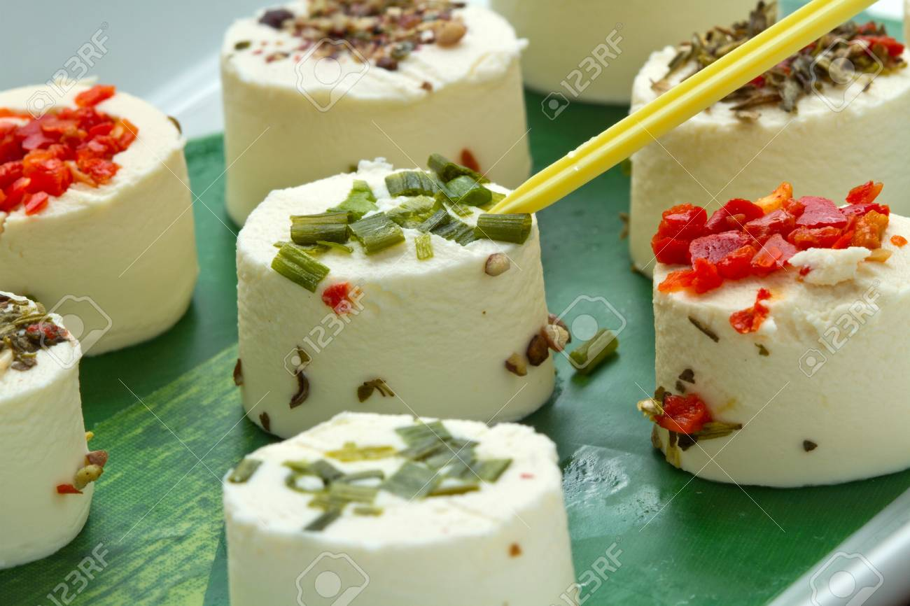 cheese with spices  on wooden background Stock Photo - 10069063
