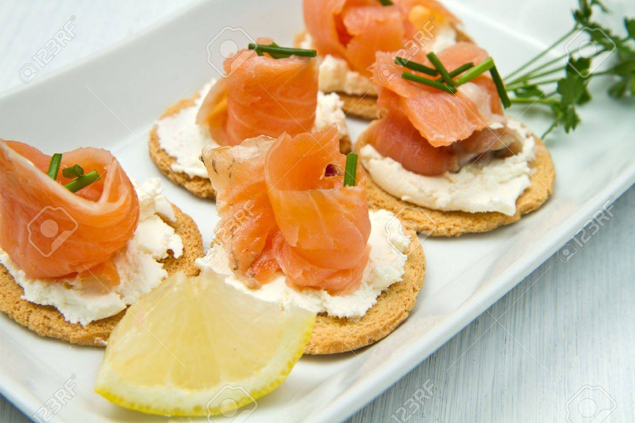 Canape with Salmon on white dish Stock Photo - 10704466