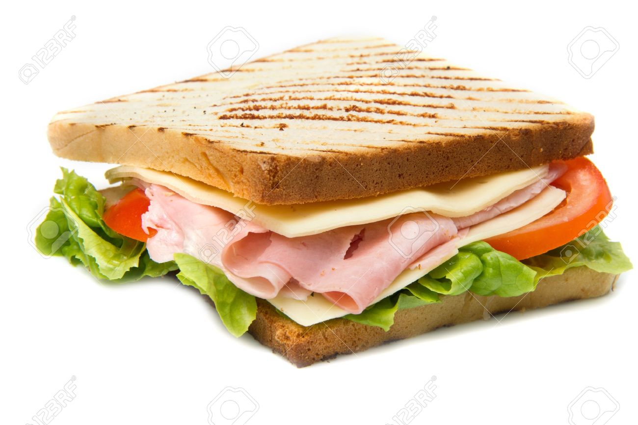 big sandwich with ham cheese tomatoes and salad on toasted stock