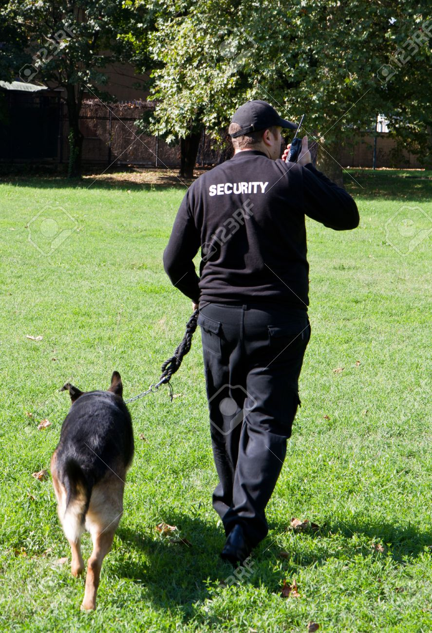back of a security guard with a dog Stock Photo - 15261357