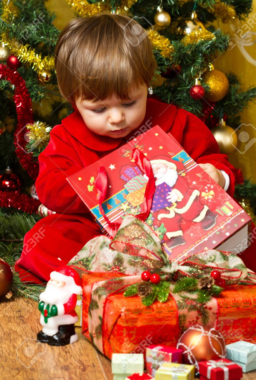 baby open present box at Christmas tree Stock Photo - 16010370