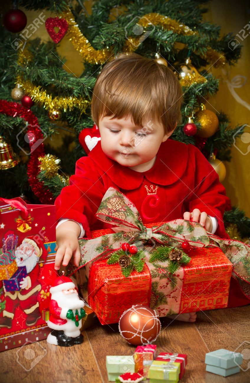 Baby Play With Present Box At Christmas Tree Stock Photo, Picture ...