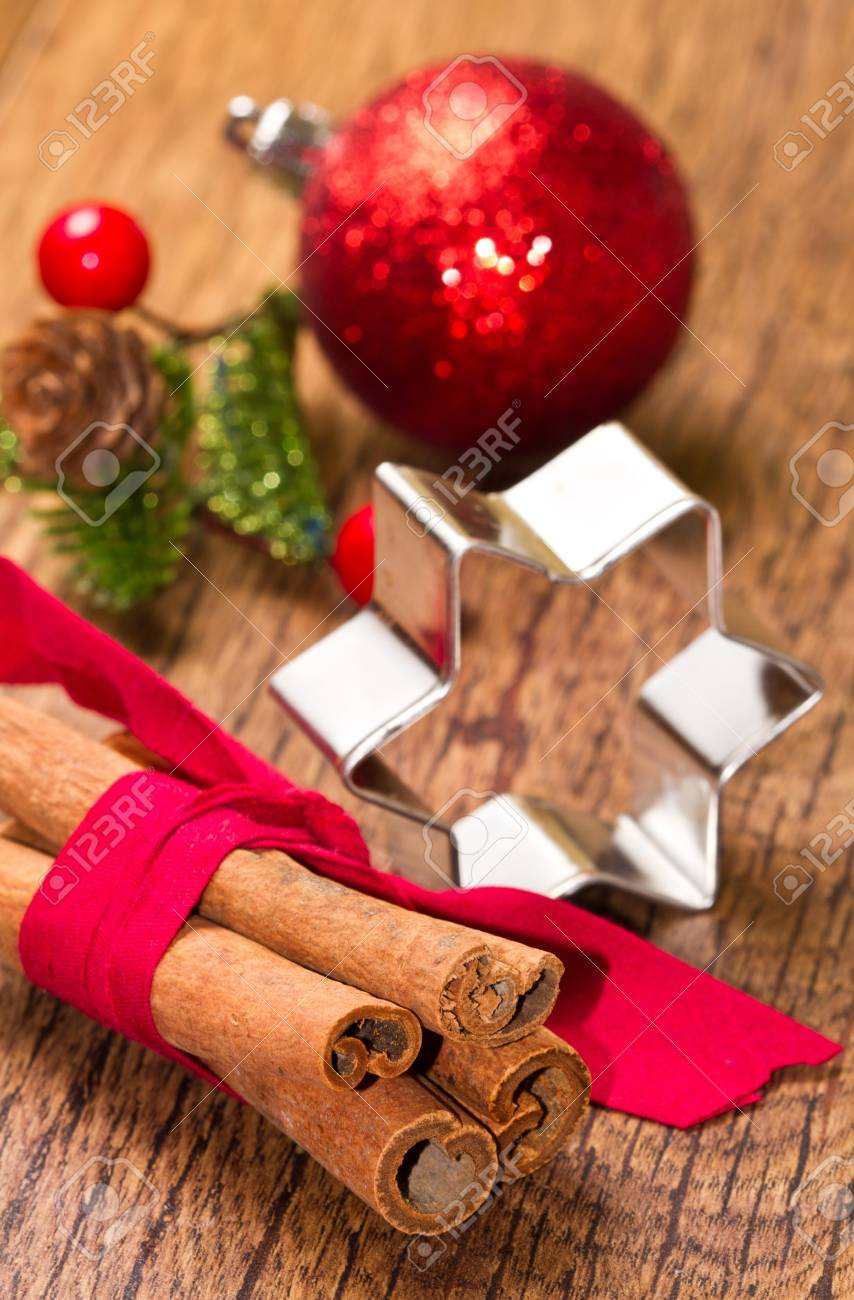 cinnamon sticks with decoration on wooden background Stock Photo - 17088914