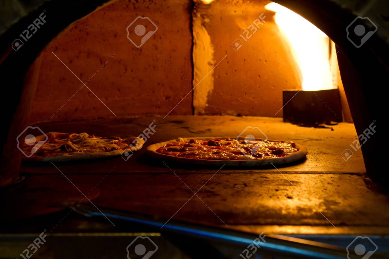 an italian Pizza baking in the oven - 17682530