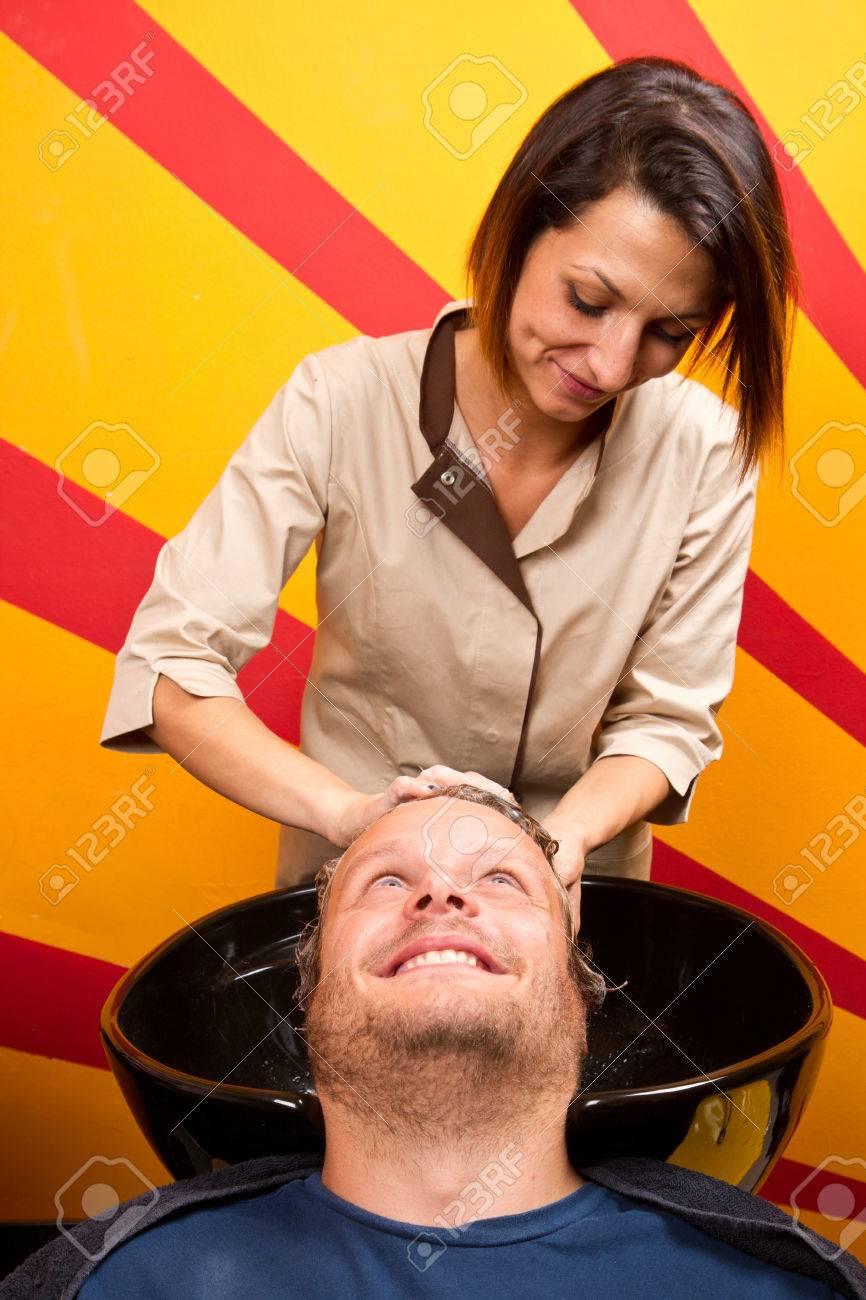 Washing man hair in beauty parlour hairdressing salon Stock Photo - 23568946